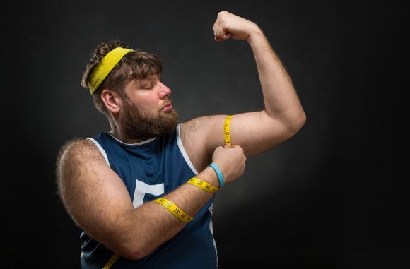 Chubby Man Measuring Muscle