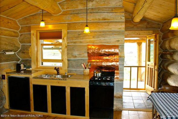 Interior of one bedroom log cabin for sale