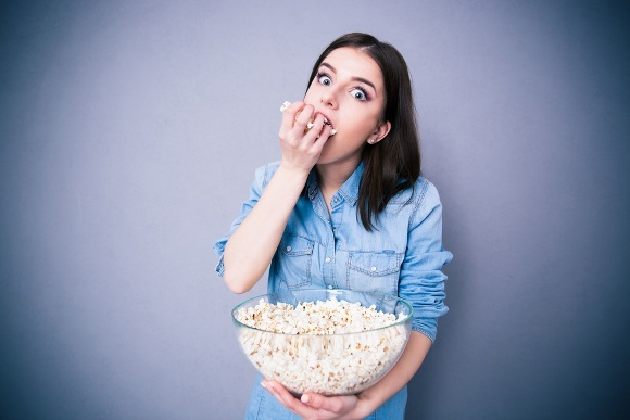 Girl is Eating Popcorn