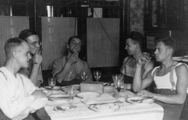 vintage young guys at dinner with cigars
