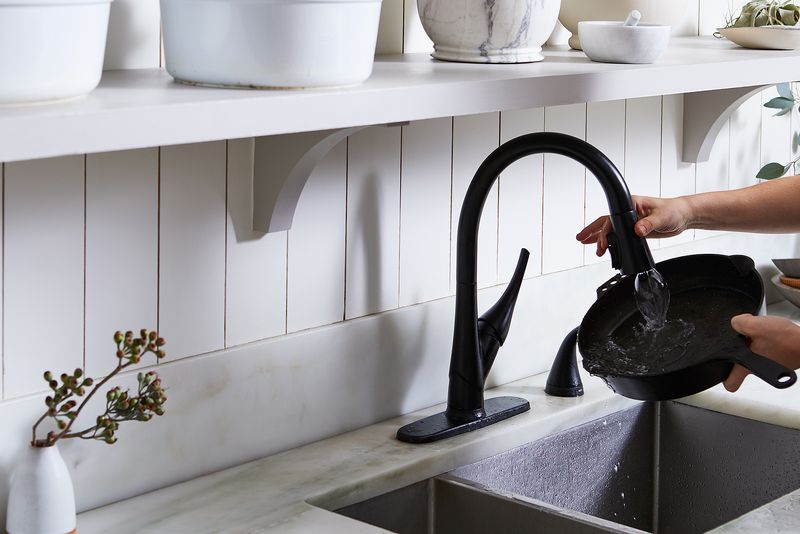 Pans make good bouncing boards for water, but angle the faucet right and you'll keep it contained (we did it with help from Delta Faucet ShieldSpray™ technology).