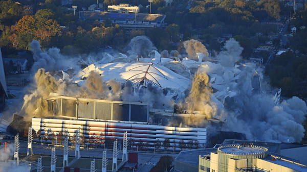 The Georgia Dome implodes during a scheduled demolition Monday. The stadium played host to the 1996 Olympic Games, two Super Bowls and Atlanta Falcons home games.
