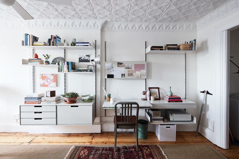Open shelving makes Alex's home office feel airy—just like the rest of her space.