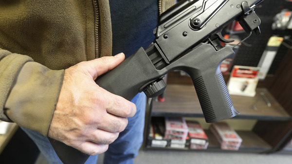 A bump stock device is shown on a semi-automatic rifle at a gun store in Salt Lake City.