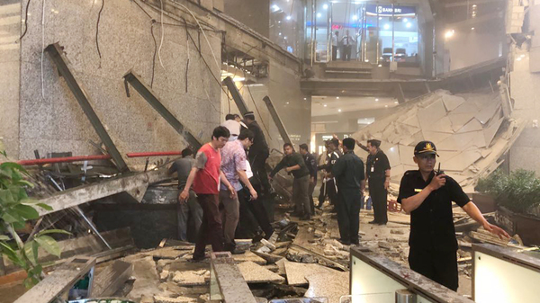 Indonesian security stand near the ruin of a structure inside the Jakarta Stock Exchange tower in Jakarta, Indonesia, on Monday.
