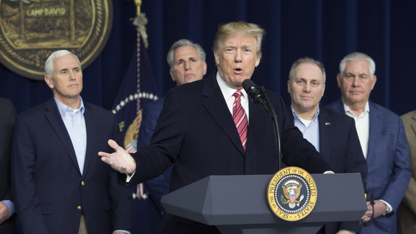 President Donald Trump speaks to the press after holding meetings at Camp David Saturday. Trump met with staff, members of his Cabinet and Republican members of Congress to discuss the Republican legislative agenda for 2018.