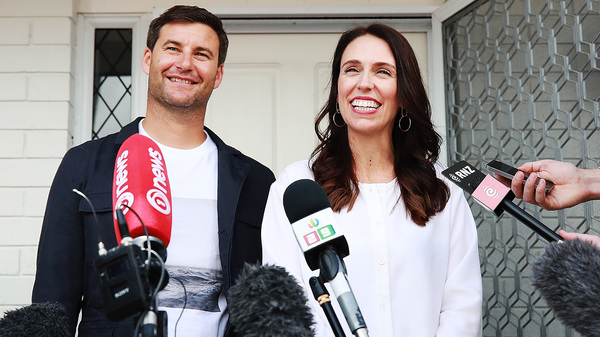 New Zealand Prime Minister Jacinda Ardern and her partner Clarke Gayford speaking reporters in Auckland, New Zealand.
