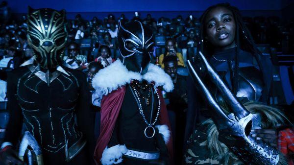Costumed viewers pose before watching Black Panther in Nairobi, Kenya, on Wednesday.