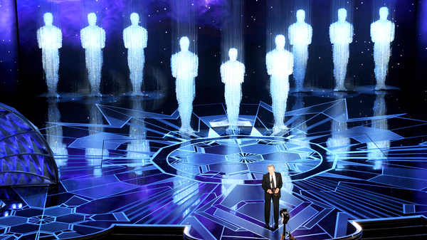 Christopher Walken presents the award for best original score at the Oscars on Sunday, at the Dolby Theatre in Los Angeles.