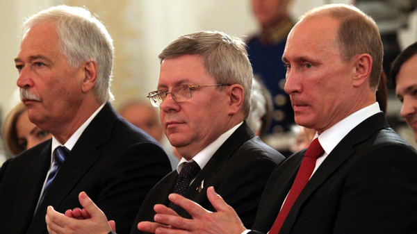 Russian politician Alexander Torshin, standing next to then-Russian prime minister Vladimir Putin, attends a ceremony at the Kremlin in 2011. Torshin is a lifetime member of the National Rifle Association, and says he met Donald Trump through the group in 2015.
