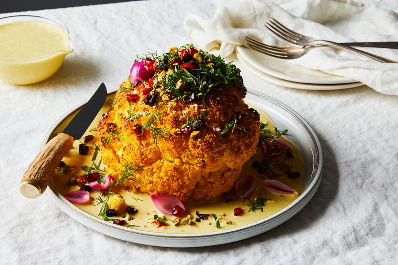 Whole Roasted Cauliflower with Turmeric-Tahini Sauce & Pistachios