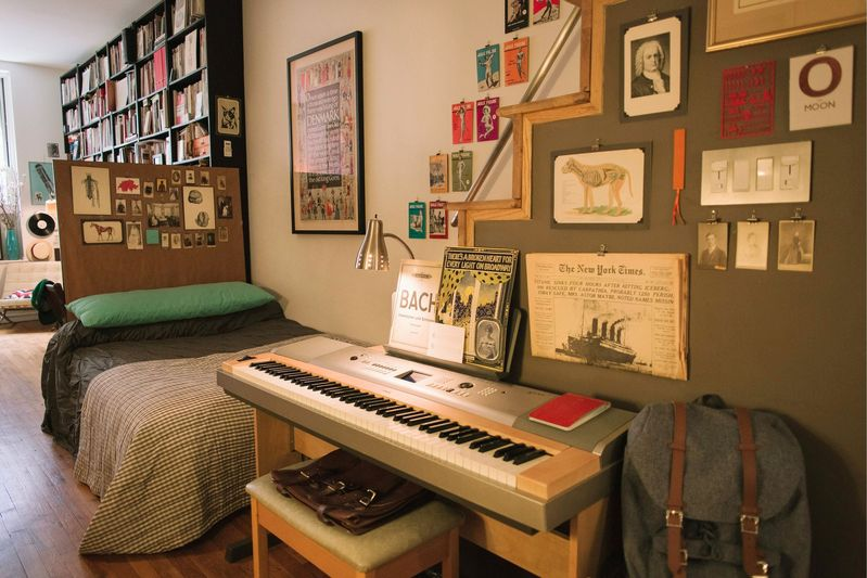 """My piano, which I still play every day. Those stairs lead up to the loft, which I use as storage now."""