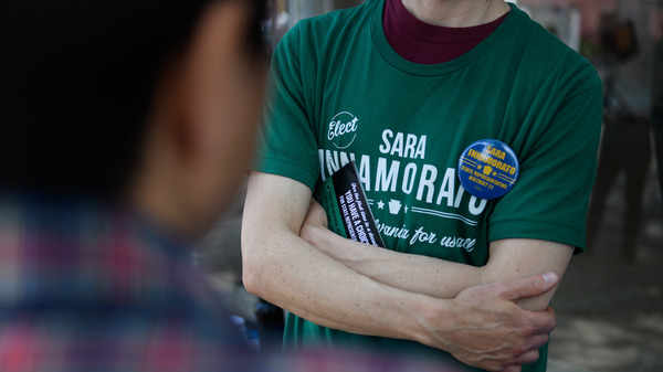 A campaign worker wears a shirt in support of Sara Innamorato outside a polling location at the Oakmont United Methodist Church in Pittsburgh. The first-time candidate declared victory over a five-term incumbent in the Democratic primary for House District 21.