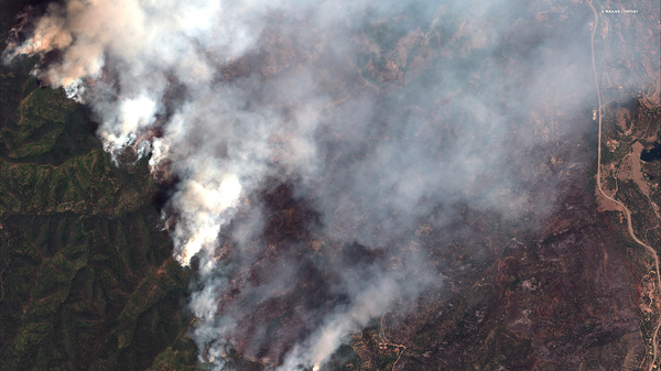 A satellite image provided by DigitalGlobe shows the 416 Fire northwest of Hermosa, Colo., which has forced the closure of the San Juan National Forest.