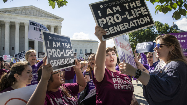 Anti-abortion rights advocates demonstrate in front of the Supreme Court early Monday.