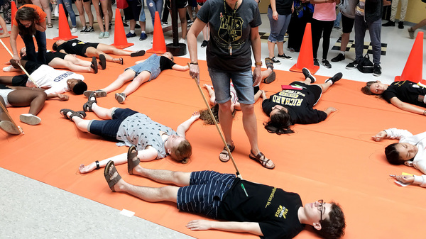Students and faculty at Richard Montgomery High School in Rockville, Md., take part in a die-in demonstration to call for an end of gun violence at schools.