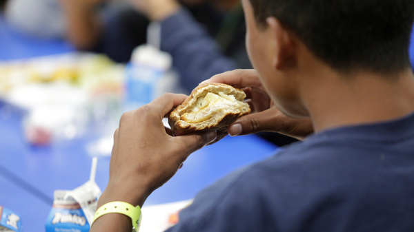 A child eats at an unaccompanied alien children program shelter in Brownsville, Texas, in an undated handout photo that was obtained from the Department of Health and Human Services by Reuters. The government says it separated nearly 2,000 children from adults at the U.S. southern border over the course of six recent weeks.